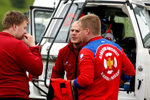 Rescue workers, planning the next move.