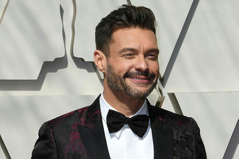 Margir kannast við hinn glaðbeitta Ryan Seacrest úr American Idol.
