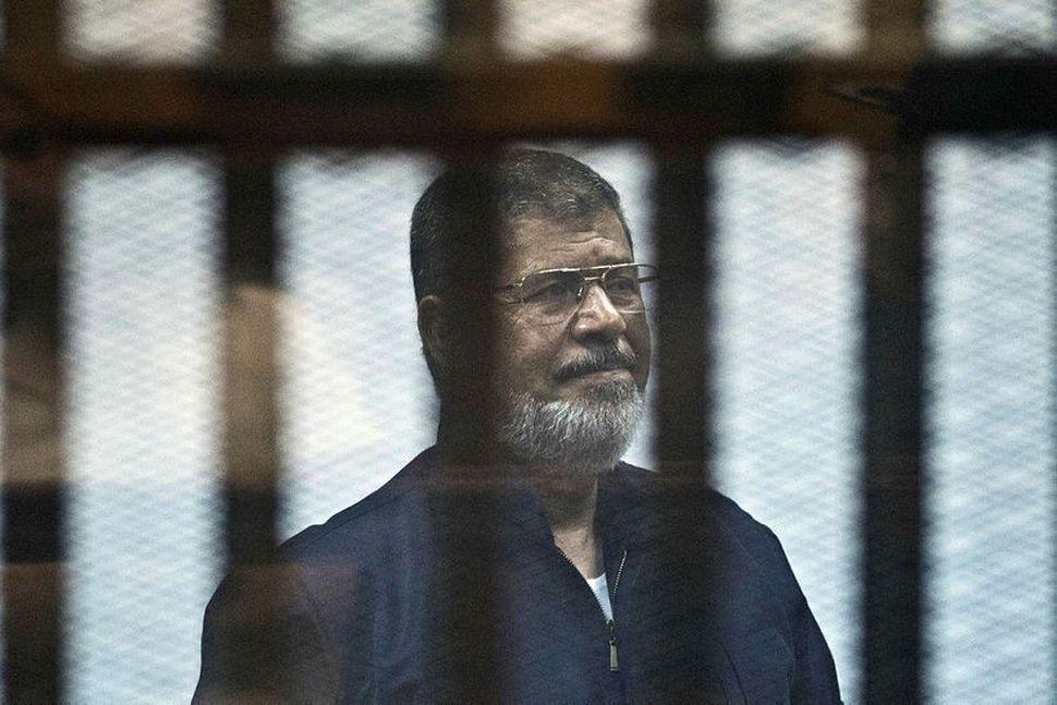 Morsi var 67 ára gamall og hefur sætt fjölda ákæra ...