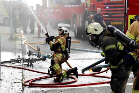 Fire fighters at work yesterday.