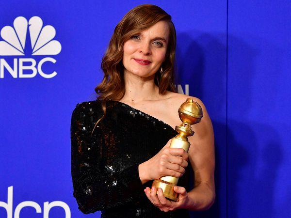 Hildur, holding the Golden Globe award.