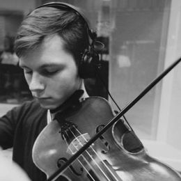 Bizub is an accomplished musician, skilled in the viola, piano and violin.