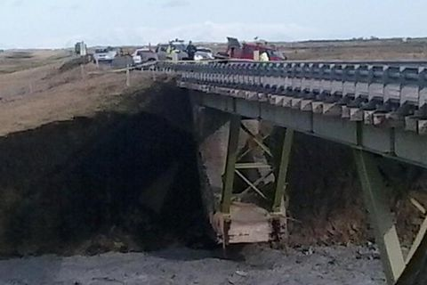 The bridge's support structure exposed.