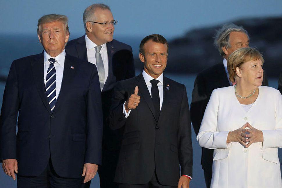 Donald Trump Bandaríkjaforseti með þeim Emmanuel Macron Frakklandsforseta og Angelu ...