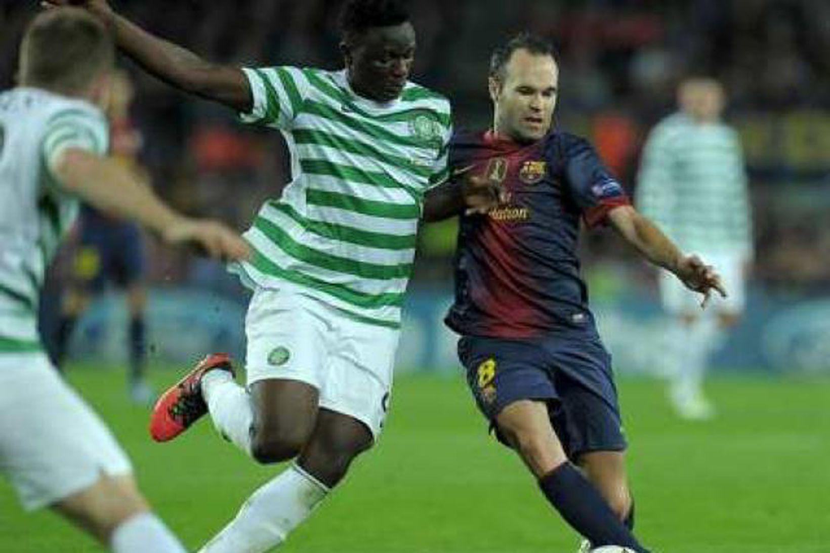 Victor Wanyama í baráttu við Andrés Iniesta, leikmann Barcelona.