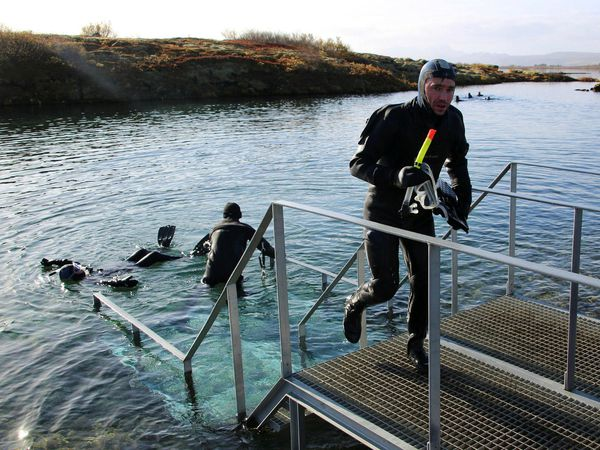 Divers in Silfra fissure.
