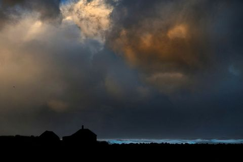 Clouds paint the sky just before a storm hits the seaside town of Hafnir in Reykjanes.