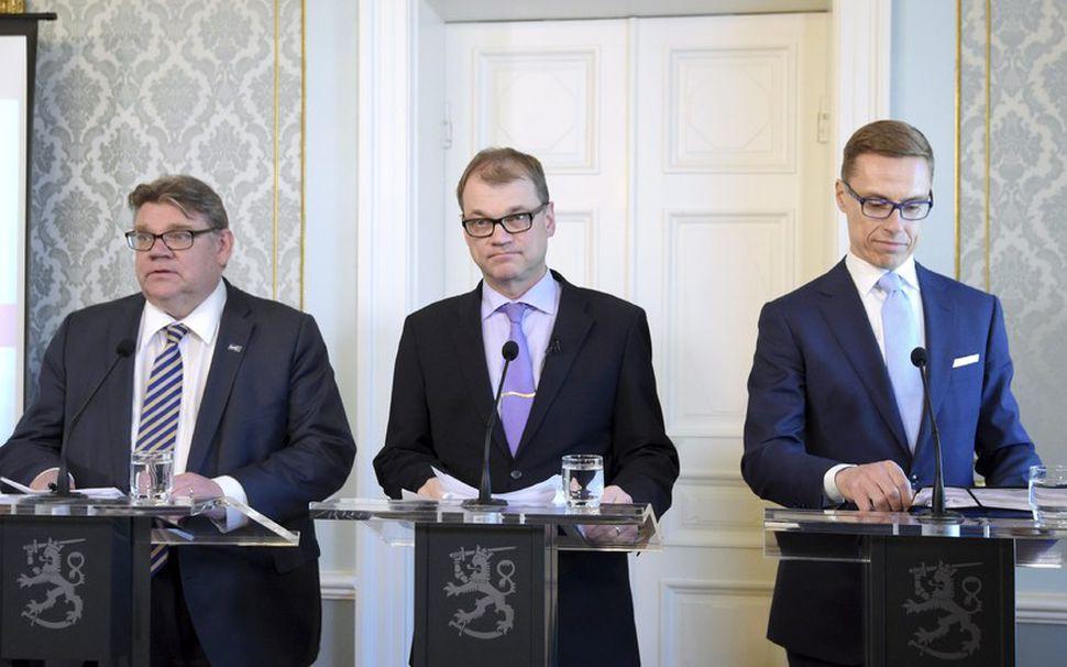 Leiðtogar nýrrar ríkisstjórnar Finnlands: Timo Soini, leiðtogi Sannra Finna (t.v.), ...