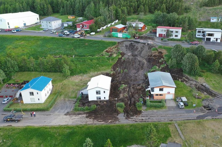 The landslide caused considerable damage to two houses.