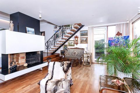 That seventies feel complete with  a Spanish style staircase and a  brick fireplace.