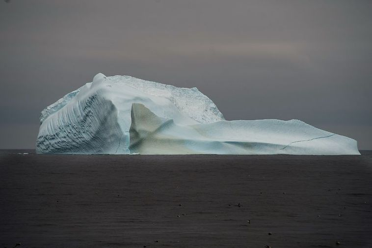 This beautiful iceberg is stranded in the middle of the ocean.