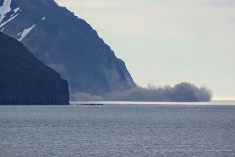 A landslide occurred in Hvanndalabjargi mountain Saturday night. The picture was taken on Hrísey island.
