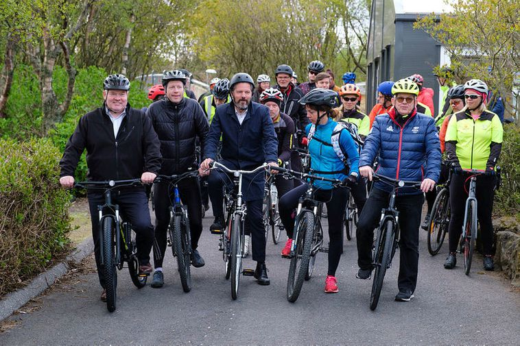 Officials and guests getting ready to ride their bikes in Laugardalur Park yesterday.