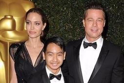 Angelina Jolie, Maddox Jolie-Pitt og Brad Pitt.