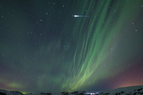 An Iridium flare is seen here in the upper part of the photograph, to the left of the Northern Lights.