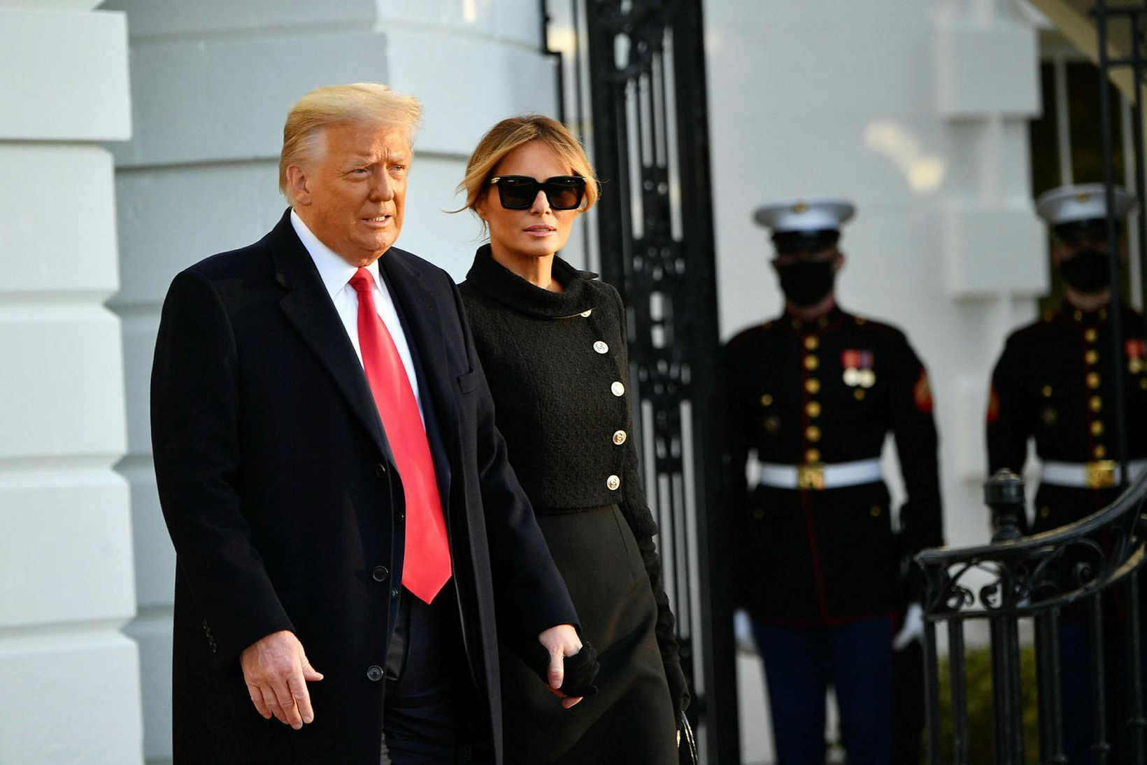 Trump fyrr í dag ásamt forsetafrúnni Melaniu.