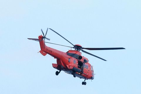 The Icelandic Coast Guard helicopter was called off, because a boat near the accident site rescued the crewmembers.