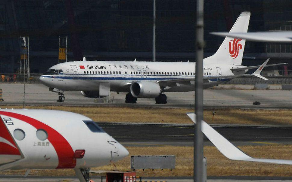 Boeing 737 MAX 8 farþegaþotur í flugvellinum í Peking. Kínversk ...