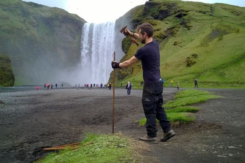 Park rangers putting up fences at Skógafoss.