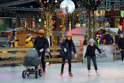 Families enjoying the ice skating rink last year.