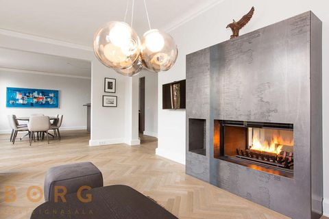 Beautiful wooden floors and a modern fireplace.