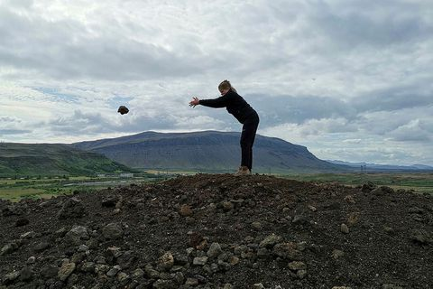 "Helena, a park ranger in Þjórsárdalur, throwing away the last of 3,219 rocks from a ""wart"" near Hjálparfoss waterfall."