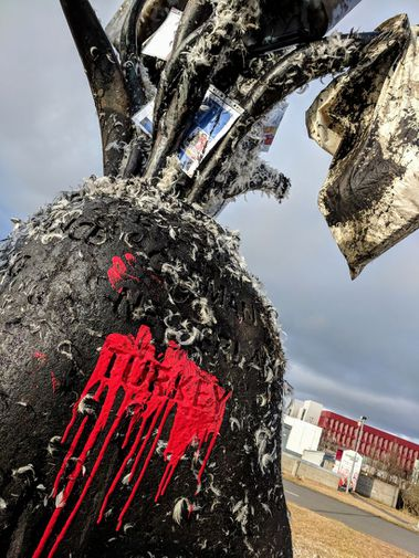 Red paint was splashed on the NATO statue and it was tarred and feathered.