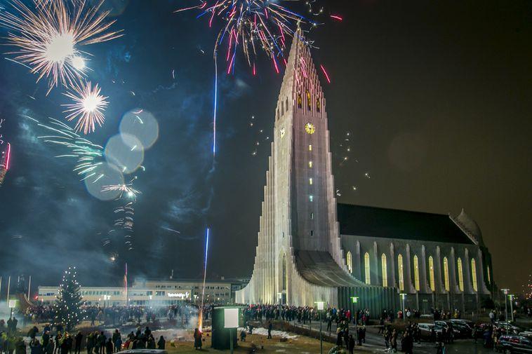 Icelanders shooting off fireworks at Hallgrímskirkja church in the centre of Reykjavík.