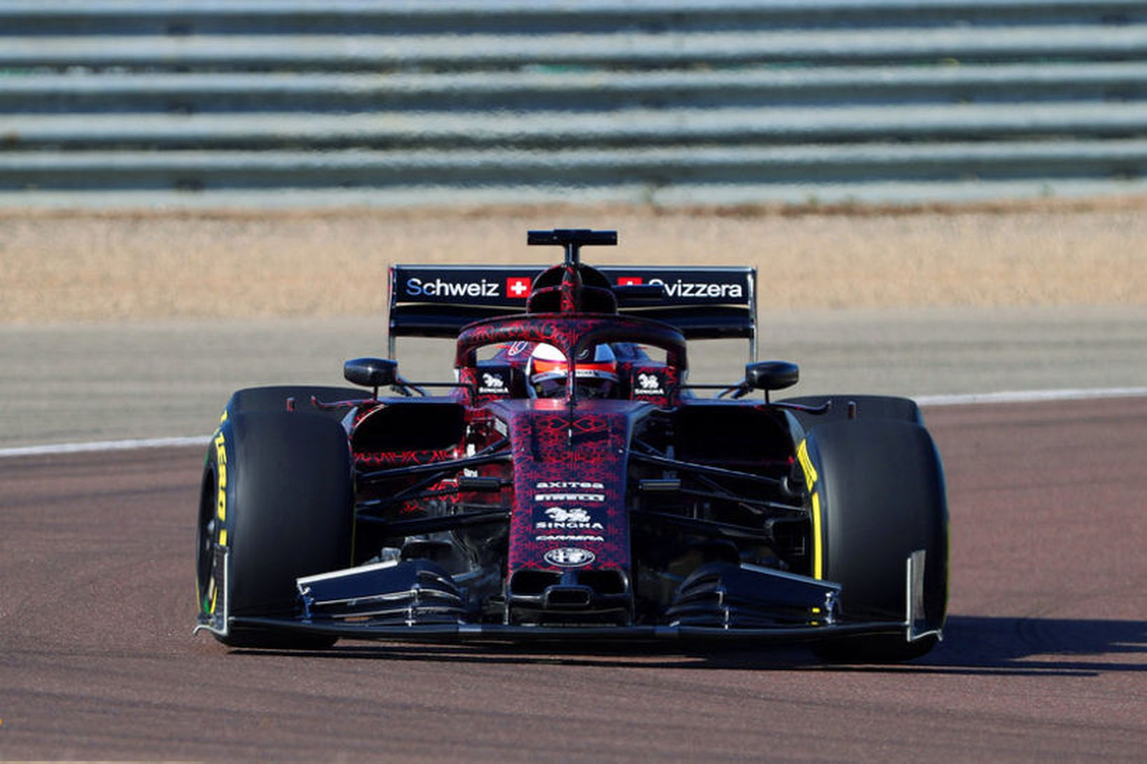 Kimi Räikkönen frumekur Alfa Romeo Sauber í Fiorano í dag. …
