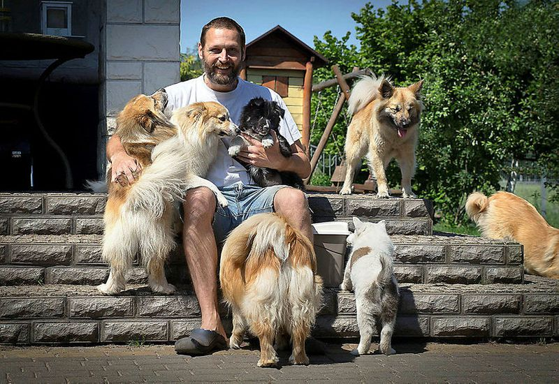 Mariusz Kopieccy, in good company in his backyard in Konin, Poland.