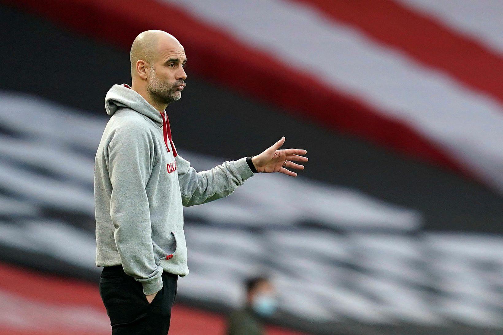 Pep Guardiola og lærisveinar hans í Manchester City eru á …