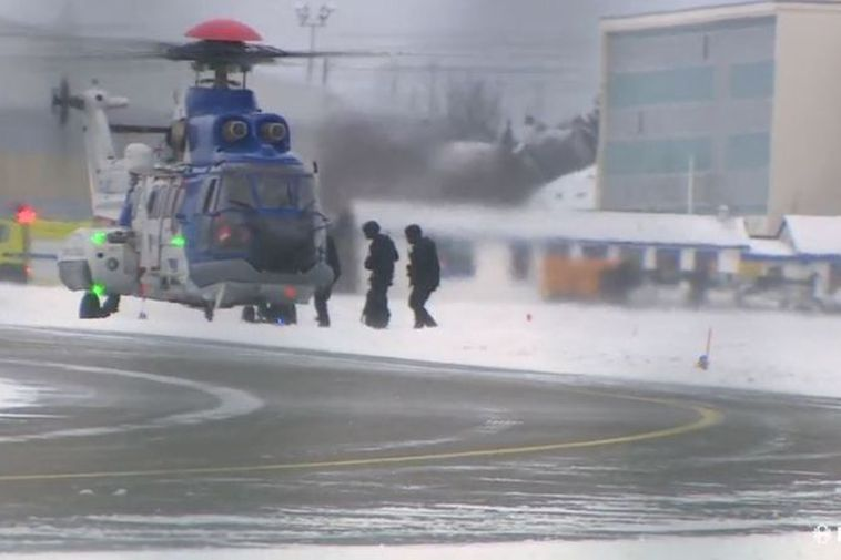 Members of the special armed police unit seen entering the helicopter which is now flying ...