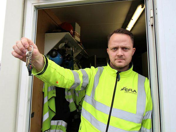 Engineer Stefán Geir Árnason, brandishing the key ring whose name is the longest word in Icelandic.