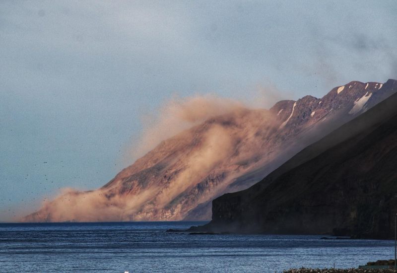 Rocks falling from Gjögur mountain, Saturday.
