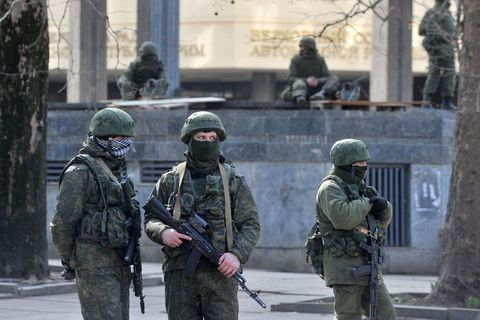 Armed men in front of the Crimean Parliament in March 2014.