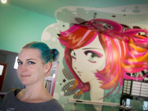 Sara Hochuli at the new Kumiko tea house. Kumiko, a Manga character, can be seen here on the wall.