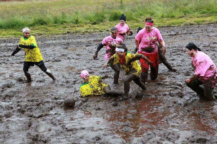 A spirited game of bog-football at a summer festival in the town of Ísafjörður. The …