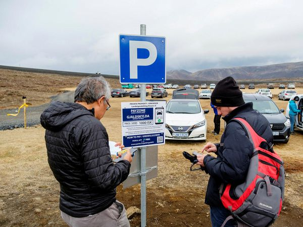Paying for parking near the eruption site.