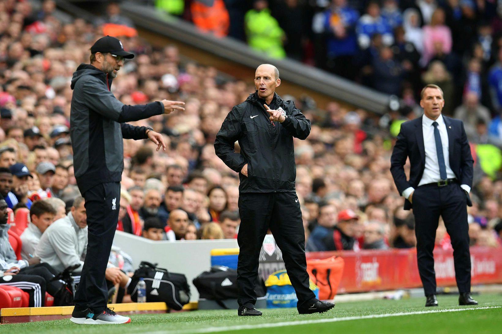 Jürgen Klopp og Brendan Rodgers á hliðarlínunni á Anfield í …