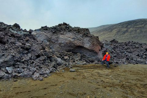 Bruce Houghton, the Hawaii State volcanologist, in front of the lava ball which has finally stopped rolling.