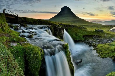 Beautiful Kirkjufell with the Kirkjufellsfoss waterfall in the foreground.