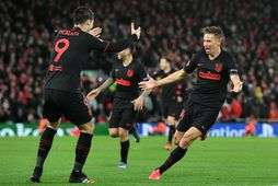 Leikmenn Atletico Madrid fagna marki gegn Liverpool.