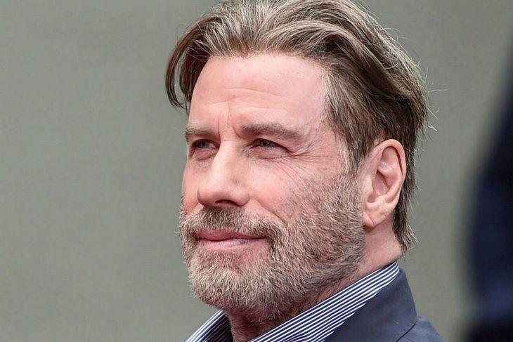John Travolta var með mikið hár þegar þessi mynd var ...