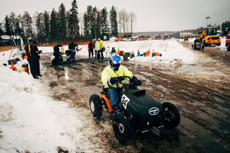 Finns are so happy that they compete in lawn-mower racing during wintertime.
