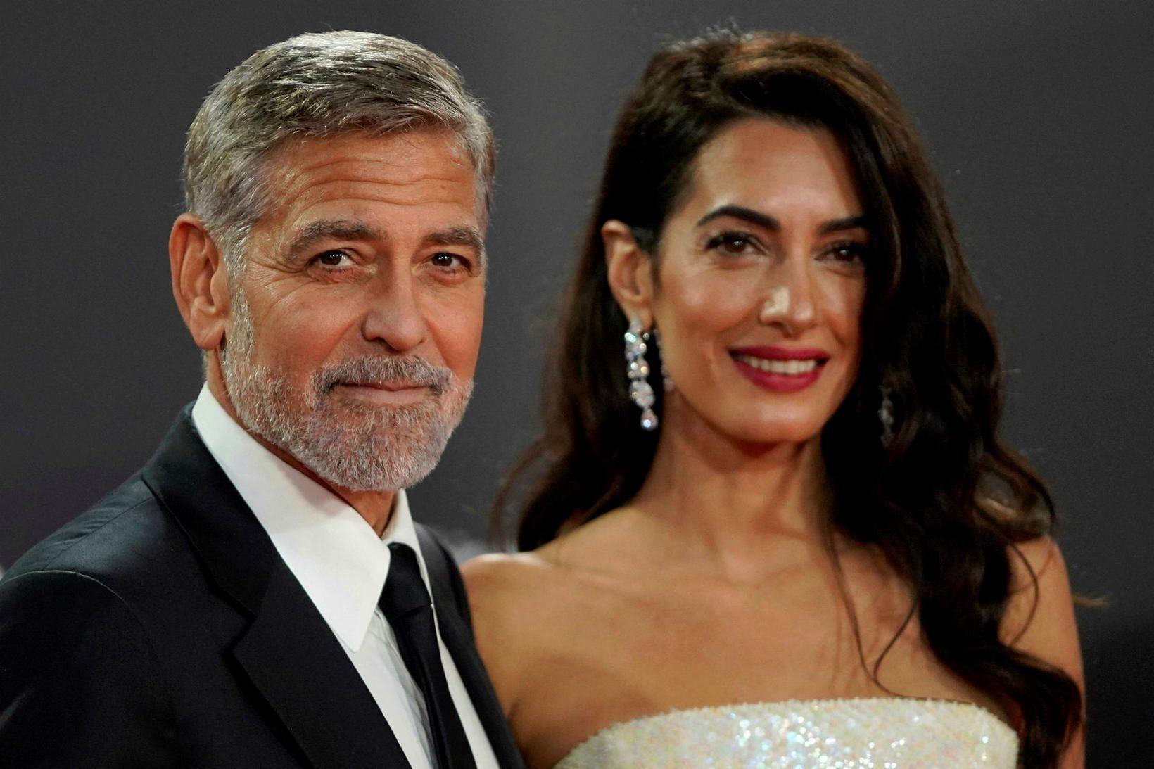 Amal Clooney ásamt eiginmani sínum George Clooney.