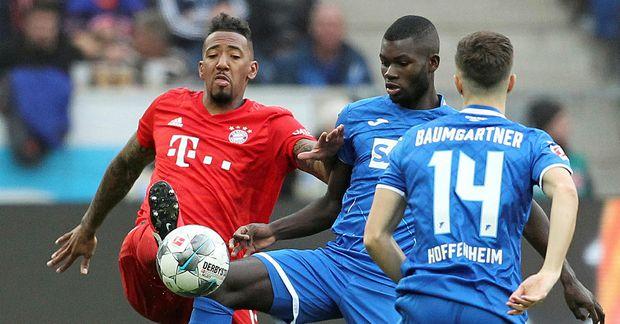 Jeróme Boateng, til vinstri, í leik með Bayern gegn Hoffenheim.