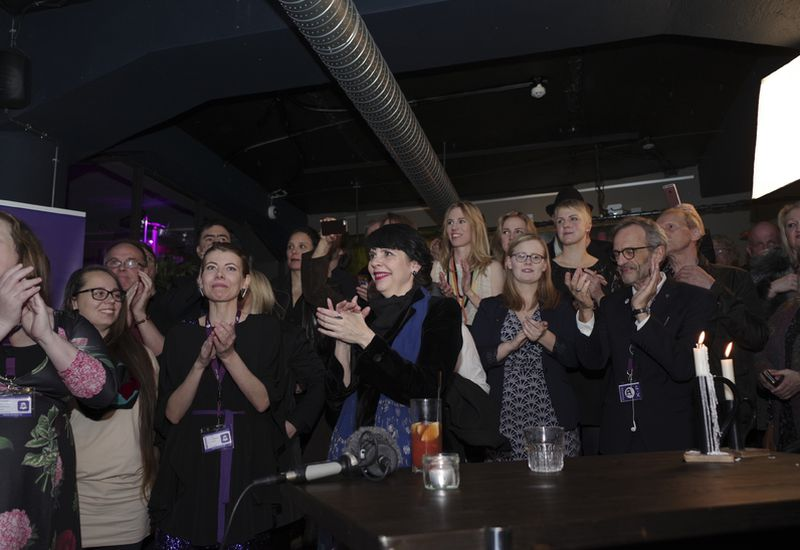 Members of the Pirate Party cheer as vote results are announced.