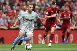 Jack Wilshere í leik með West Ham United gegn Liverpool fyrir þremur árum.