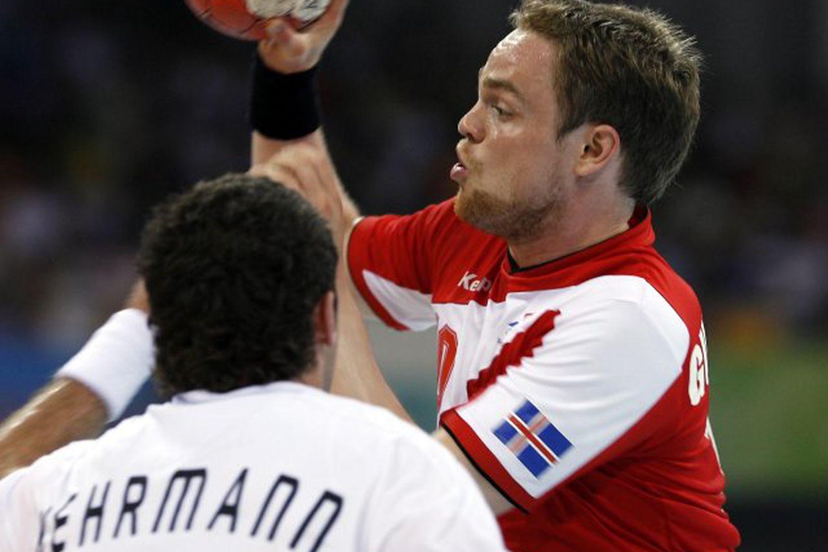 Florian Kehrmann og Snorri Steinn Guðjónsson eigast við í landsleik …