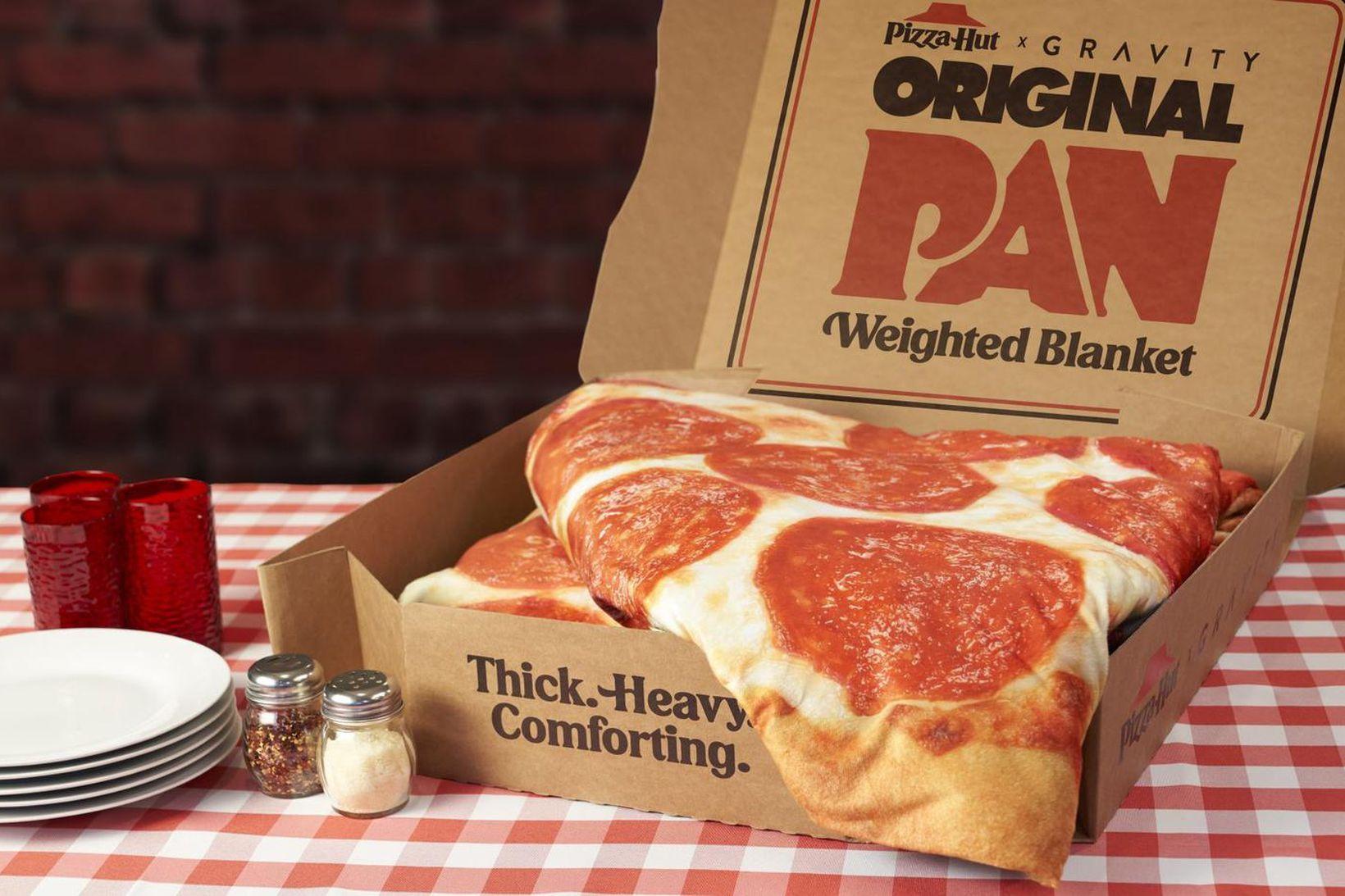 Pizza Hut selur djúsí kósíteppi sem mun halda á þér …